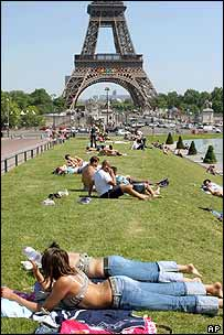 Young people sunbathe during a summer heat wave in Paris