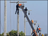 Workers repair power lines, AP