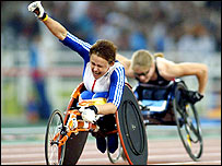 Tanni Grey-Thompson celebrates winning the 100m at the Athens Olympics