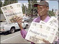 Newspaper seller in Zimbabwe