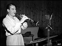 Artie Shaw is shown playing the clarinet on 10 September 1941 at an unknown location