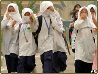 Children protecting their faces from the haze