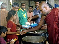 Buddhist monks distribute food in Galle