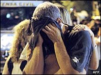 A relative of a victim of the Buenos Aires nightclub fire cries