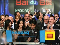 Staff from Baidu.com celebrate the start of trading in its shares in the US