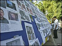 Photographs of missing people, posted outside a morgue in Takuapa, Thailand