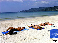 Tourists lying on Thai beach