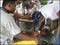Red Cross volunteers help the wounded