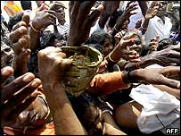 Displaced people struggle for food packets at a relief camp in Nagapattinam, south of Madras in India.