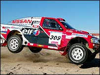 Colin McRae and co-driver Tina Thorner in their Nissan
