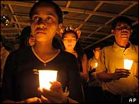 People remember the victims of Sunday's tsunami, on New Year's Eve in East Timor