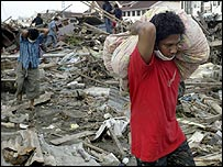 Survivors retrieve their belongings from the devastated commercial district of Banda Aceh, in Indonesia