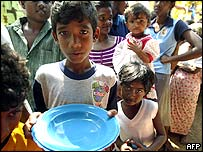 Sri Lankan children queue for food at camp for displaced people in the south-western coastal town of Hikkaduwa