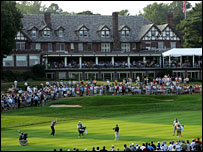 The clubhouse at Baltusrol as Davis Love plays the 18th