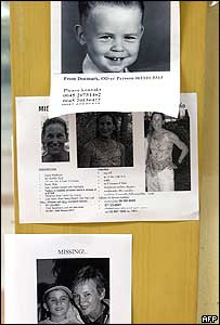 Notices show photographs of foreign tourists missing during the tidal waves disaster in southern Thailand, at Phuket airport, 01 January 2004.