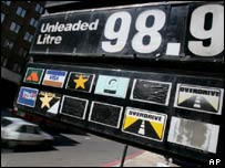 Petrol price board in London showing 98.9 pence a litre