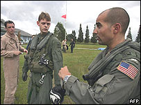 US Navy personnel from the USS Abraham Lincoln talk after touching down at the airport in Banda Aceh, 01 January 2005