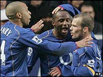 Arsenal's Fredrik Ljungberg celebrates with Thierry Henry and Patrick Vieira