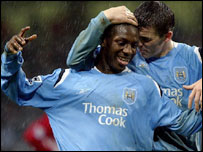 Joey Barton congratulates Shaun Wright-Phillips