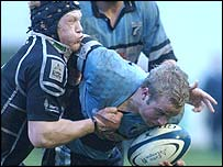 Ospreys try-scorer Richard Pugh tackles Bles scrum-half Ryan Powell
