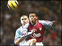 Nolberto Solano heads Aston Villa's winning goal