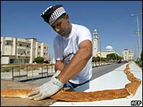A baker in Jenin preparing the world's longest baguette