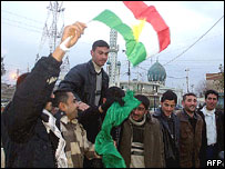 Iraqi Kurds celebrate in Kirkuk, 2005, after announcement of February's election results