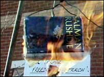 The Satanic Verses being burned in 1989