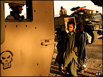 Afghan children watch US soldiers in Zabul province
