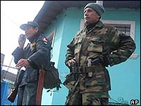 Army major Antauro Humala (right) listens as one of his supporters speaks, in Andahuaylas