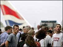 Passengers queue outside Terminal 4