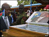 Uganda President Yoweri Museveni with the coffin of John Garang