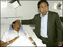 President Toledo visits an injured policeman in Lima, Peru