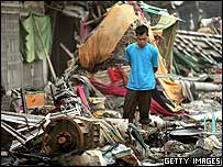 A man surveys the devastation in Banda Aceh, Indonesia