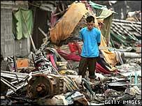 A man surveys the devastation in Banda Aceh, Indonesia
