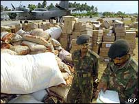 The Indian military distributing aid on one of the islands