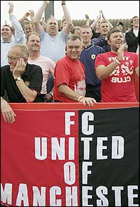 FC United fans at a friendly game with Wimbledon AFC