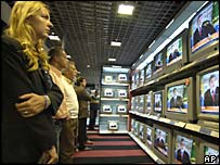 People in Brazil watch a live televised apology by President Luiz Inacio Lula da Silva
