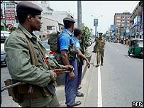 Sri Lankan troops stand guard on a Colombo street