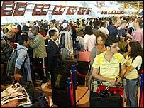 Passengers queue at Terminal 4, Heathrow