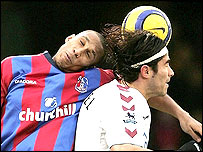 Palace defender Fitz Hall defends the ball from Juan Pablo Angel