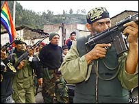Maj Antauro Humala (centre) surrounded by armed supporters