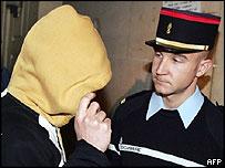 Hooded suspect Johann Bonte arrives in court