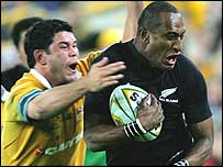 Australia hooker Jeremy Paul tries to tackle New Zealand wing Joe Rokocoko