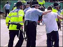 Police arrest a trouble-making football fan