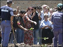 Relatives and friends lay to rest one of the victims of the nightclub disaster at Buenos Aires cemetery