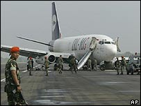 Boeing-737 cargo plane carrying relief supplies lies stranded on the runway at Banda Aceh after hitting a cow