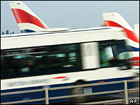 Bus at Heathrow Airport near BA airliners