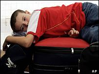 Passenger Sam Topp waiting for flight