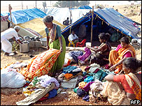 Women in India examine clothes aid packages